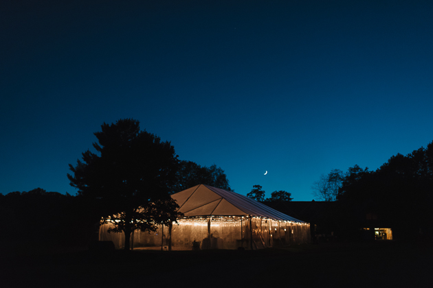A tented wedding reception under a starry sky