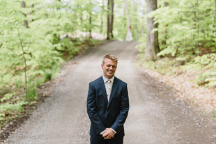A groom waiting for his bride during their Muskoka wedding