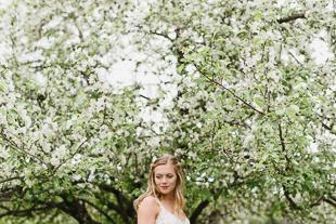A bride's portrait among the apple blooms