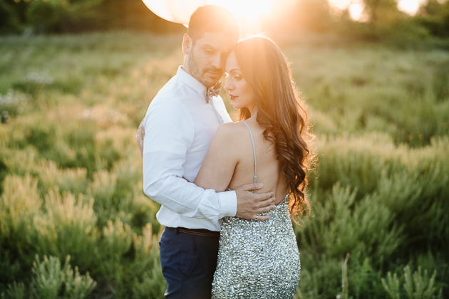 Engagement session on a large, green field