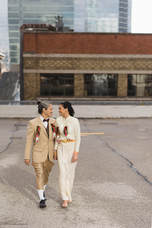 A bride and groom wearing a Thai traditional wedding attire on a Toronto rooftop wedding photos