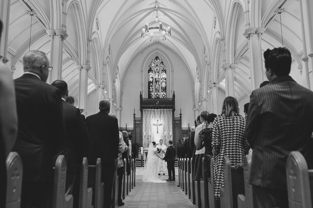 A bride and groom exchanging their vows at the church