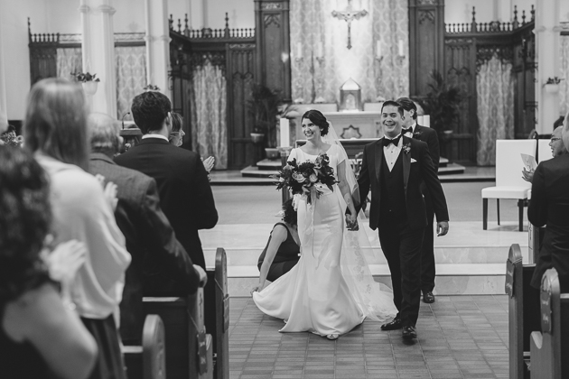 A bride and groom exiting the church / Mango Studios Toronto wedding photographers