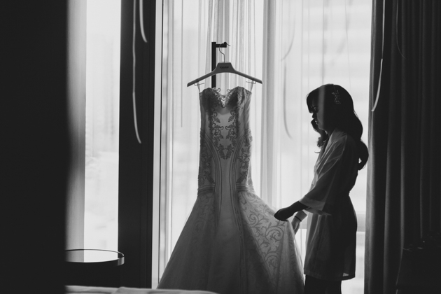 Bride putting on her wedding dress at the Four Seasons hotel