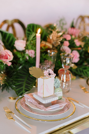 Pink wedding theme inspiration featuring marble mini cakes and golden cutlery