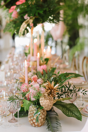 Trendy and modern wedding theme inspiration featuring gold pineapples and pink candles