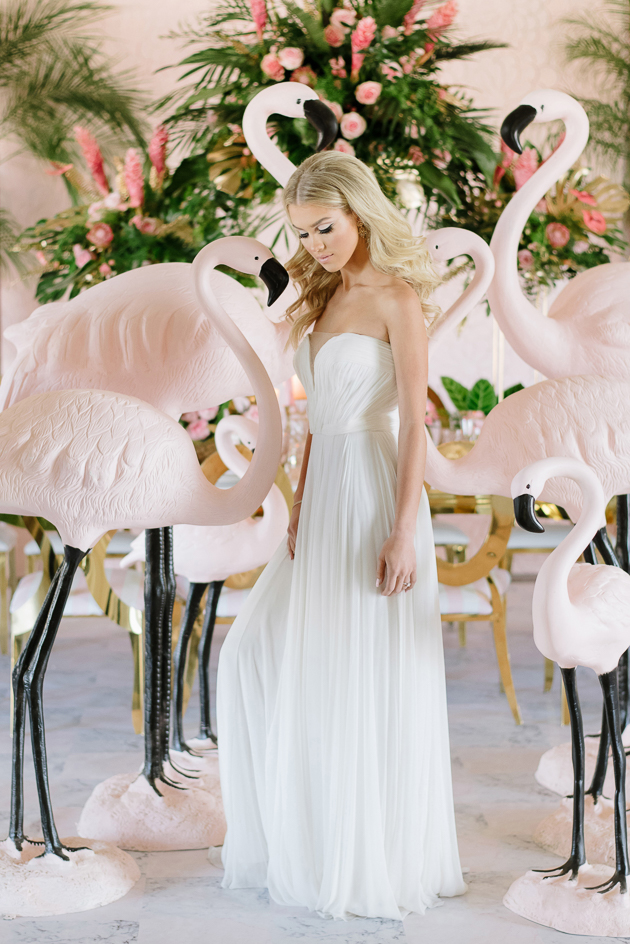 Modern and romantic pink wedding theme inspiration featuring dozens of pink flamingoes!