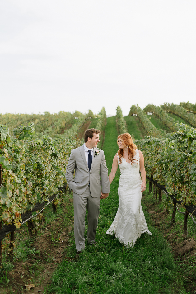 The bride and groom having a nice walk among the Ravine Estate Winery vineyard.