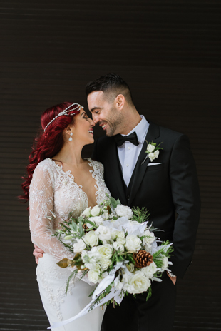 The bride and groom are all smiles during their downtown wedding photos