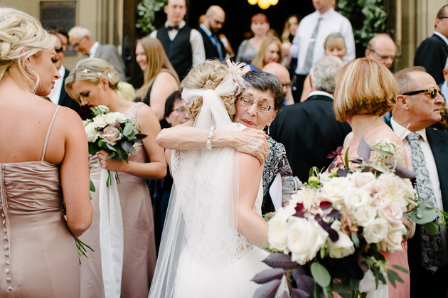 A grand mother's sweet hug right after her grandchild's wedding ceremony