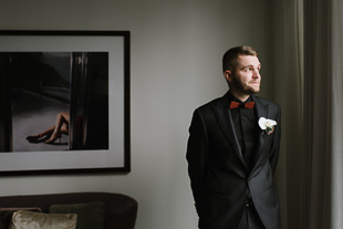 A photo of the groom waiting for his partner during the First Look