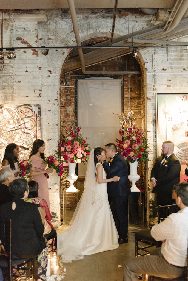 You may kiss the bride! Thompson Landry Gallery wedding at the Distillery District