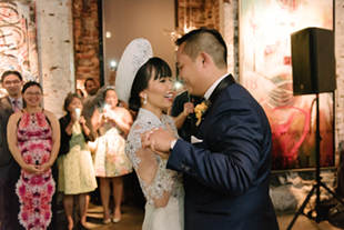 The bride and groom's first dance at the Thompson Landry Gallery wedding