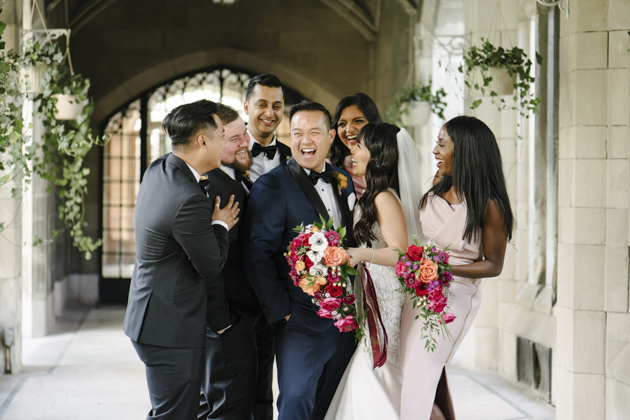 The wedding party can't hold back the laughs during their Knox College wedding photos