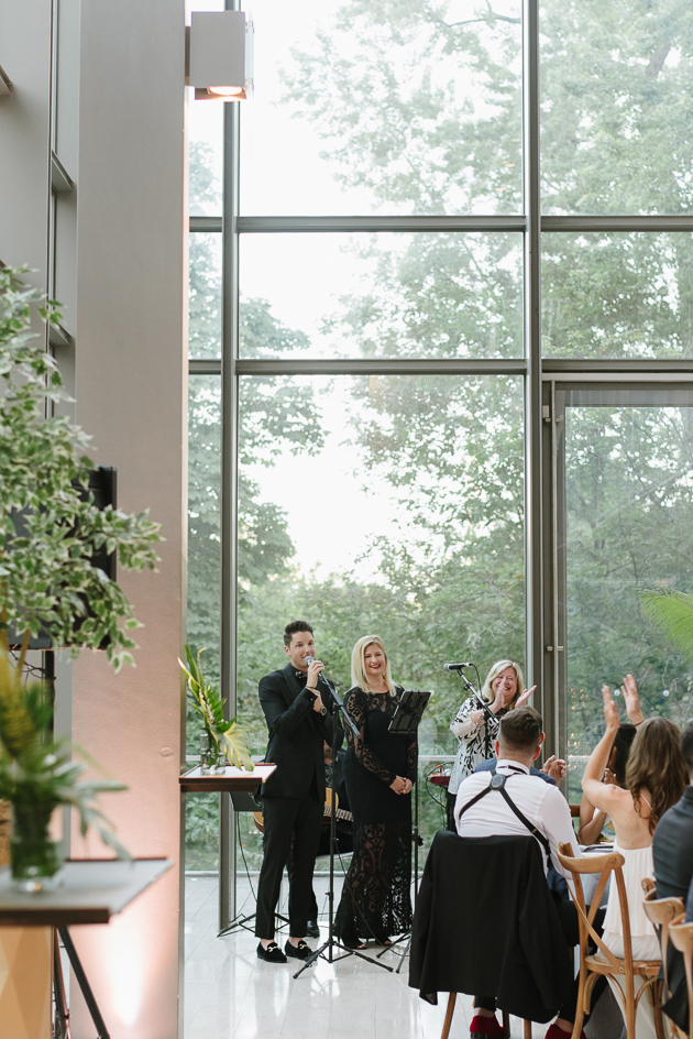 The groom performed a song during the first dance at their Royal Conservatory of Music wedding!