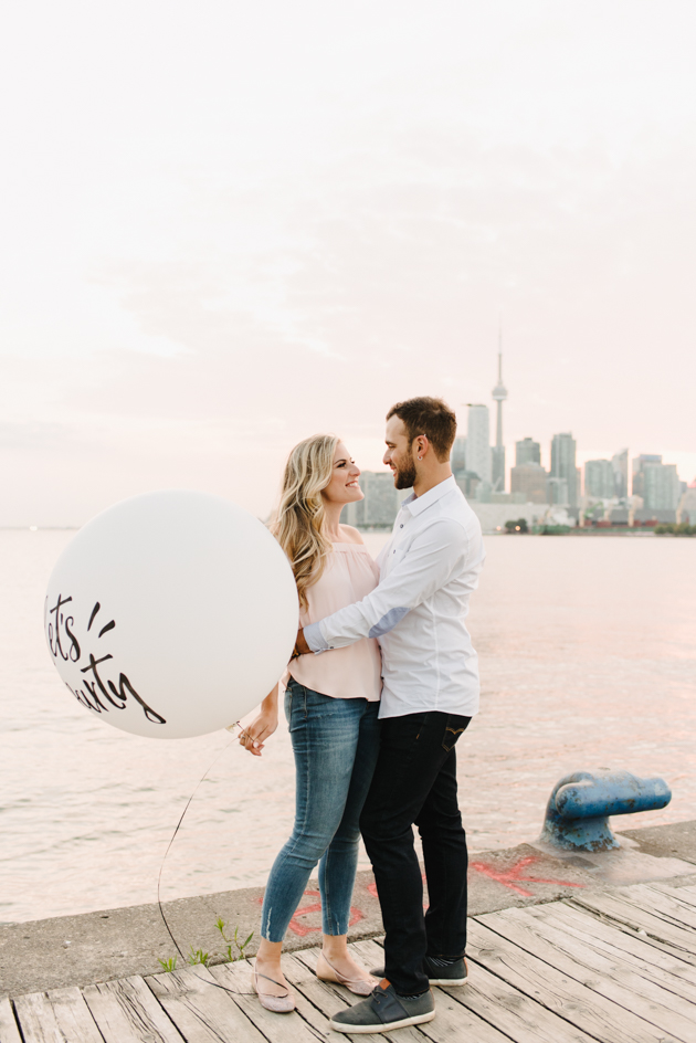 Romantic engagement photo shoot at Polson Pier in Toronto