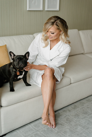 A bride and her French Bulldog on the morning of her wedding at Four Seasons Hotel Toronto