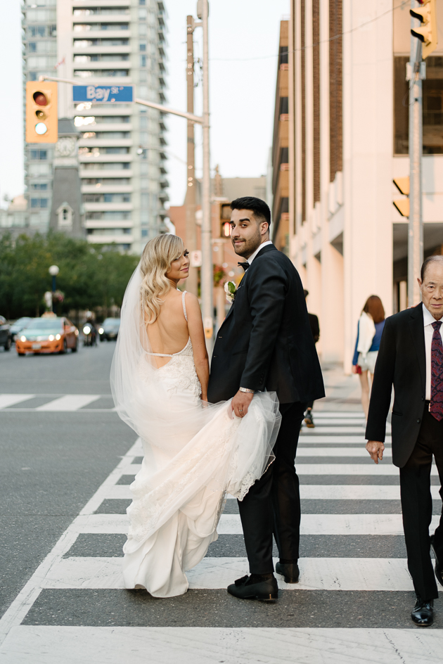 Bride and groom wedding photos near Four Seasons Hotel Toronto