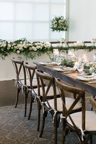 Loose greenery and white floral decor at Langdon hall wedding