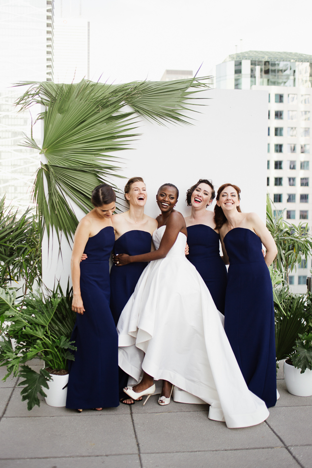 A bride and her bridesmaids on a rooftop at Malaparte