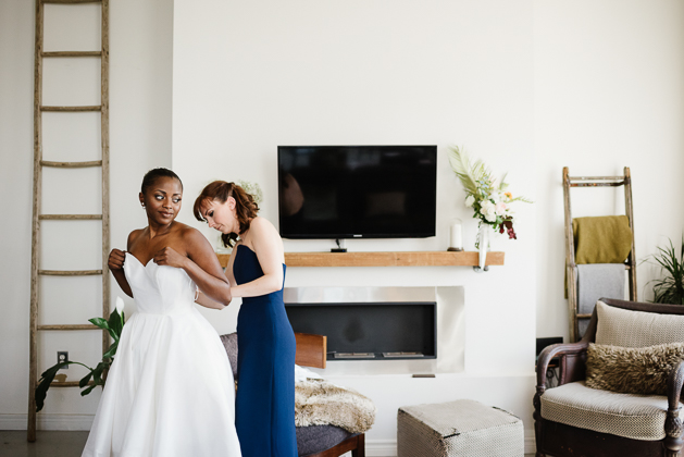 Bride getting ready in a rustic loft in Leslieville