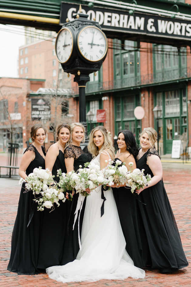 Bride and the bridesmaids in the black bridesmaid dresses