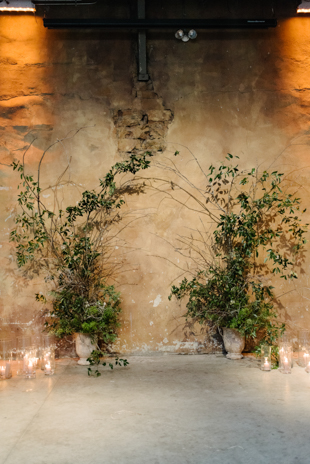Loose greenery ceremony arch