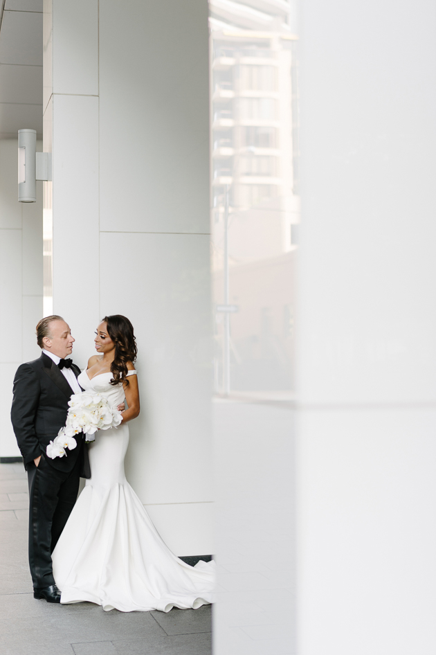 Bride and groom portraits outside of Four Seasons Hotel Toronto