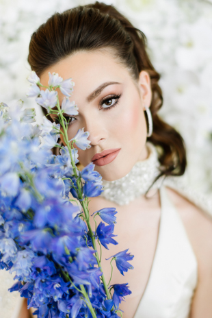 Blue bridal bouquet and a gorgeous bride at the Arlington Estate wedding inspiration shoot