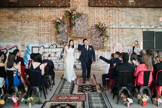 That married joy! Jenn and Jeff walking down the aisle at the Evergeen Brick Works Pop Up Chapel in Toronto