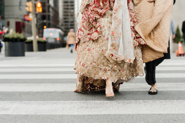 The bride and groom crossing the street in Toronto