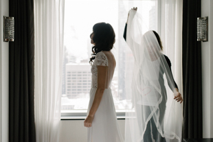Bride getting ready at a hotel on the morning of her wedding in Toronto