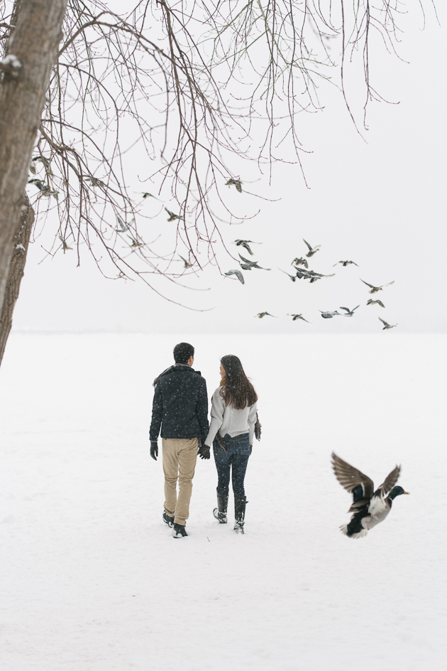 A snowy Woodbine Beach is one of the unique engagement photo locations in Toronto