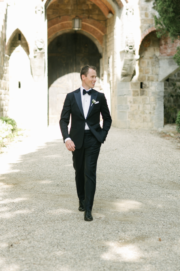 Groom waiting for his bride at Castello di Vincigliata in Florence, France