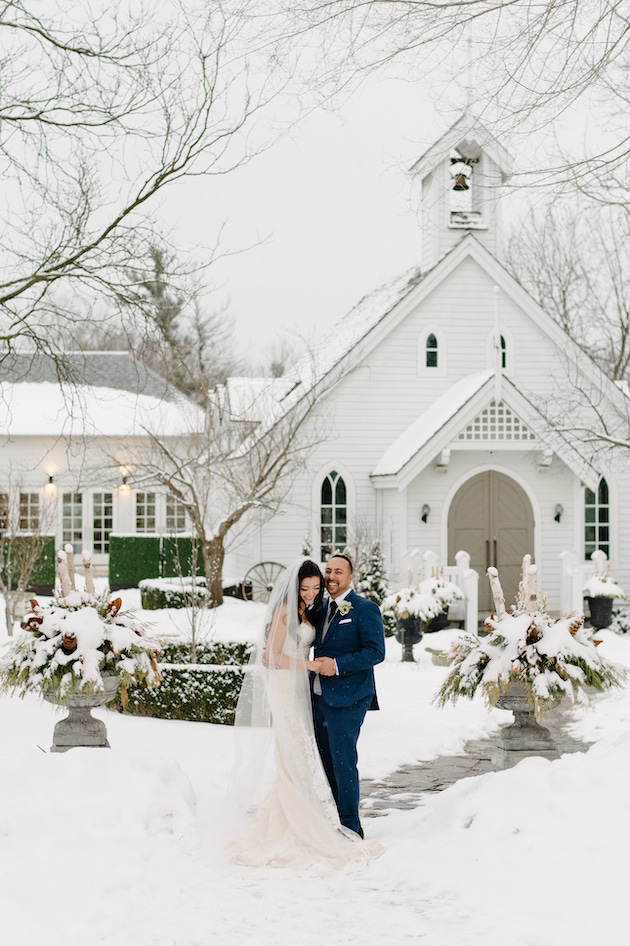 Bride and Groom taking winter wedding portraits The Doctor's House