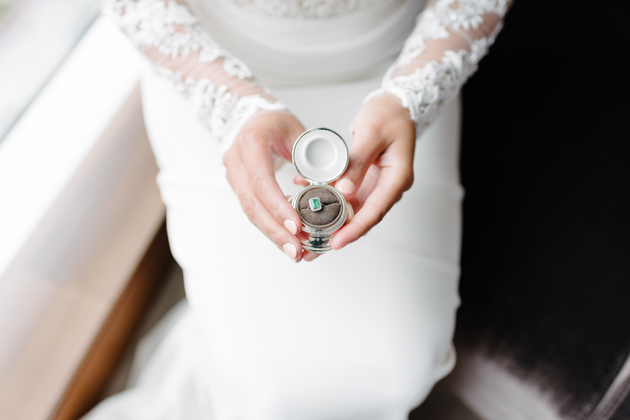 Bride holds her engagement ring in a ring box