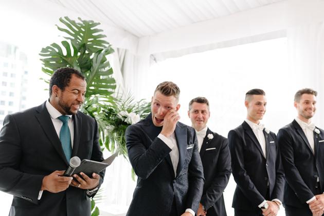 Groom sheds a tear as bride walks down the aisle