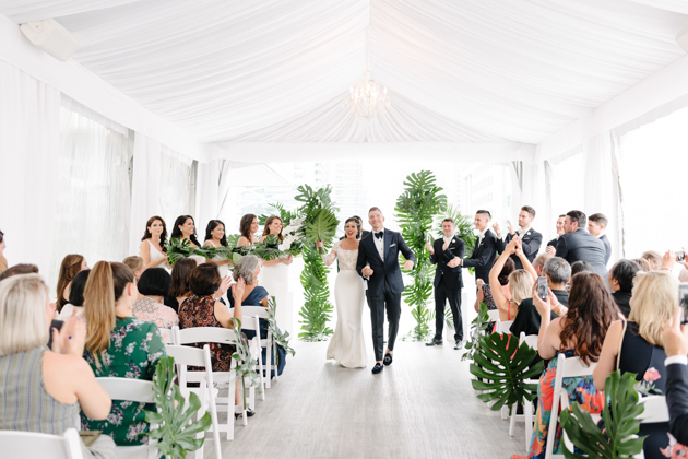 Bride and groom walk down the aisle for their recessional