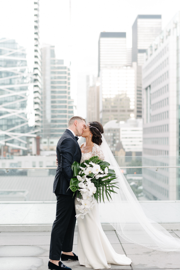 Bride and groom kiss at Malaparte