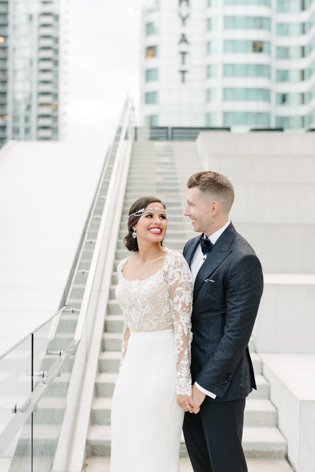 Bride and groom smile for their portrait