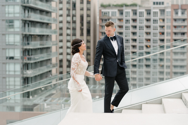 Bride and groom walk up the stairs at Malaparte