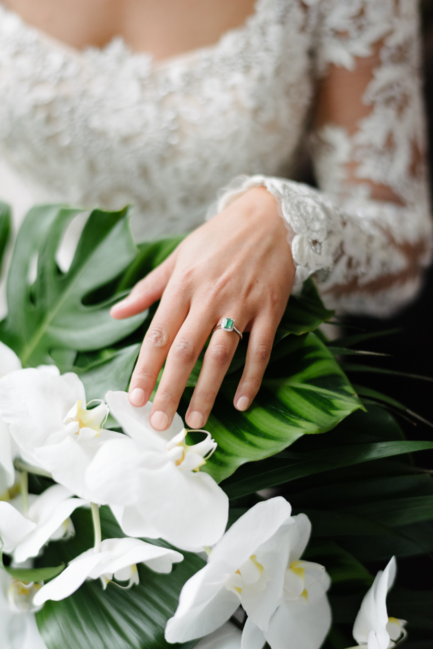 Bride holding her bouquet and wears her ring