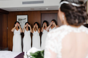 Bridesmaids close their eyes for the bride's reveal