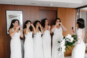 Bridesmaids sees bride for the first time