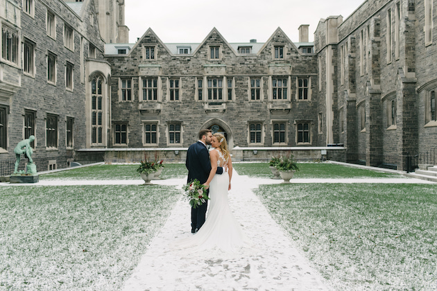 Couple kiss during their creative winter wedding photoshoot
