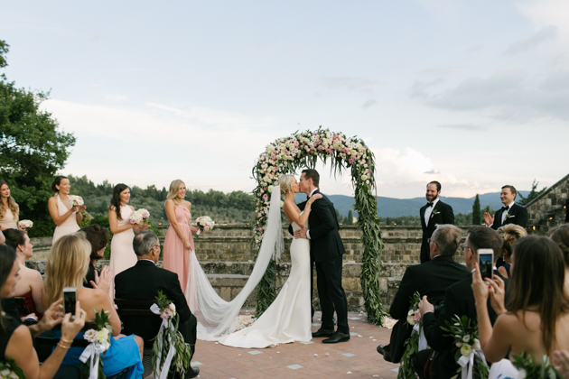 Bride and groom's first kiss at their ceremony at the Castello di Vincigliata